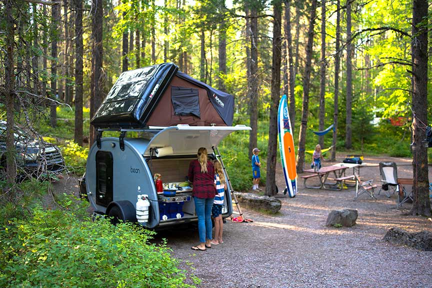 Blue Mean Bean trailer at forest campsite