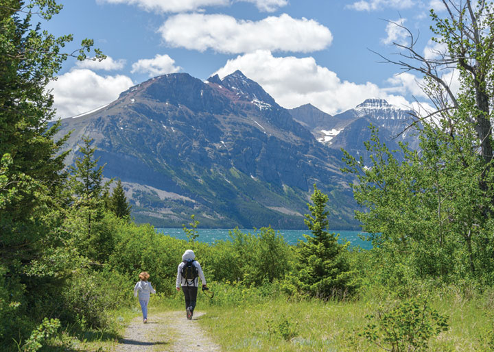 Two hikers on Beaver Pond Loop Trail at Lake Mary in Waterton Lakes National Park