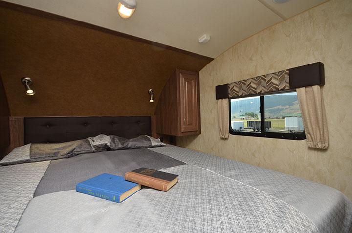 Queen bed in Northwood Fox Mountain 265RDS fifth-wheel