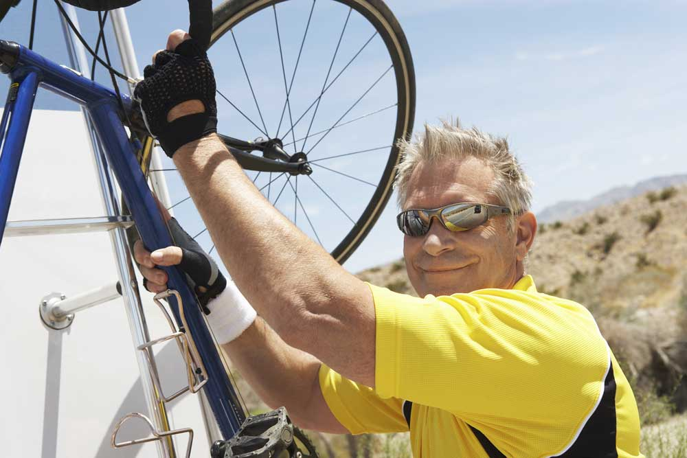 Older male bicycling RVer