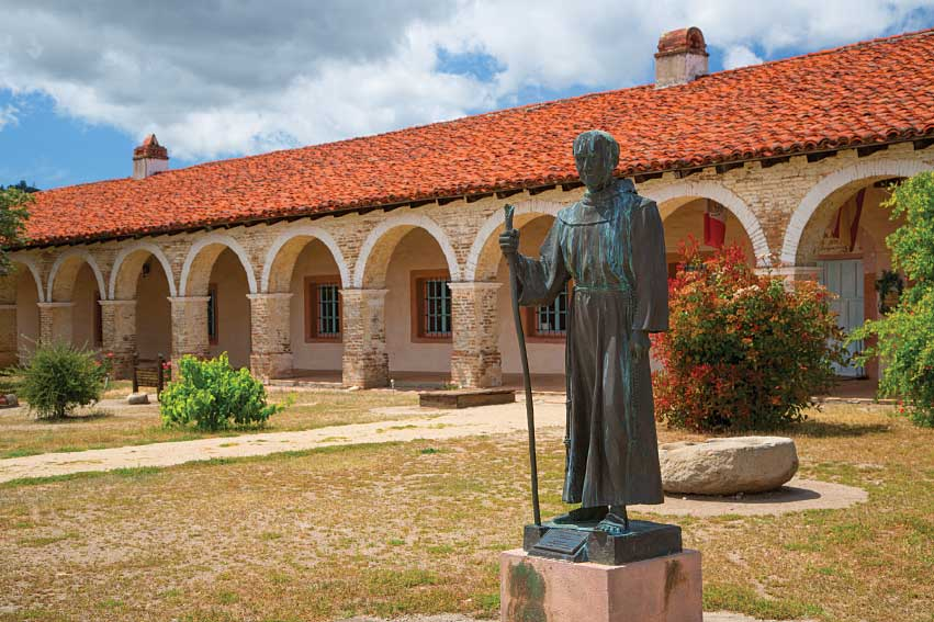 This statue of Padre Junipero Serra, one of the mission's founders, stands in front of Mission San Antonio de Padua, at Fort Hunter Liggett Military Reservation in Monterey County.