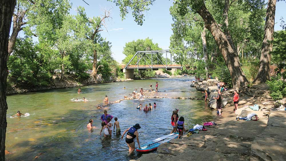 Families playing in a swimming hole along Riverwalk Trailer near Canon City, Colorado