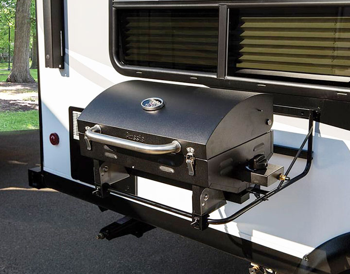 Black grill attached to side of RV