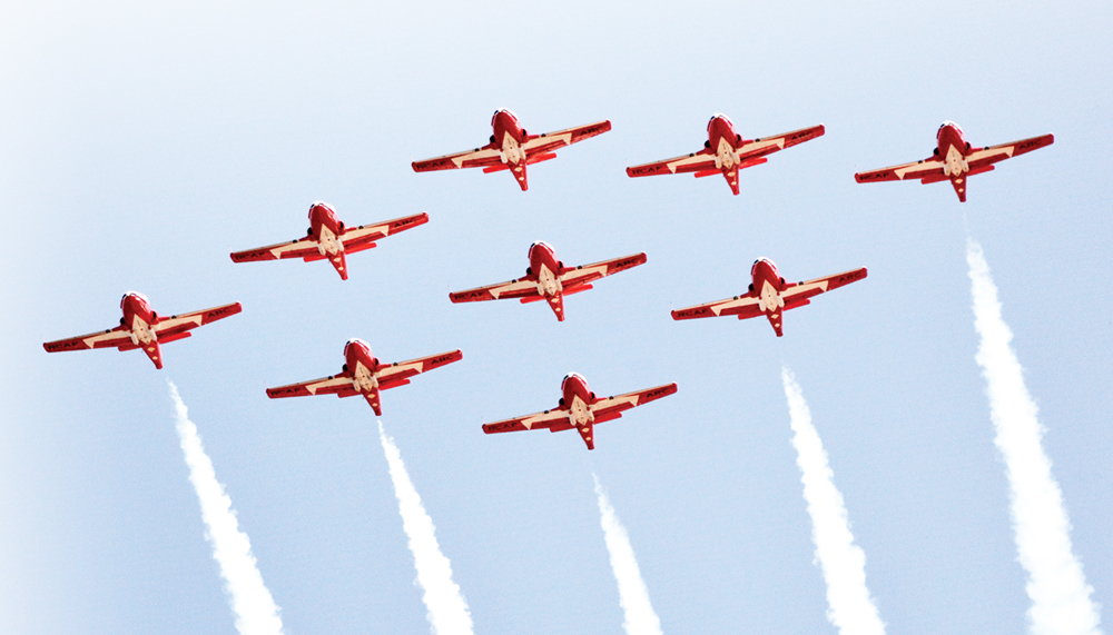 Canada's counterpart to the Blue Angels and Thunderbirds, the Canadian Forces Snowbirds wing over the Comox Air Show.