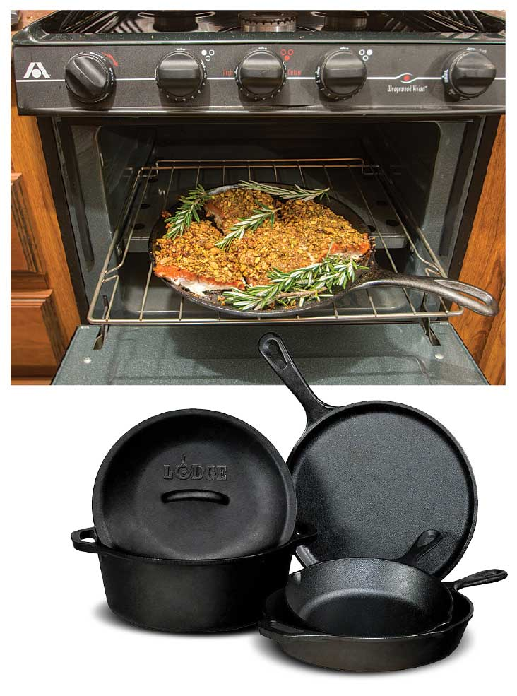 Cast Iron cookware and a crusted salmon on a cast-iron grill in an RV oven