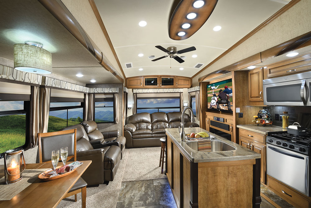 Nice living area inside motorhome with leather couches, kitchen island and table