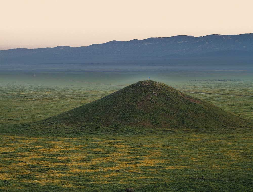A hiker is dwarfed by the expansive Carrizo Plains National Monument