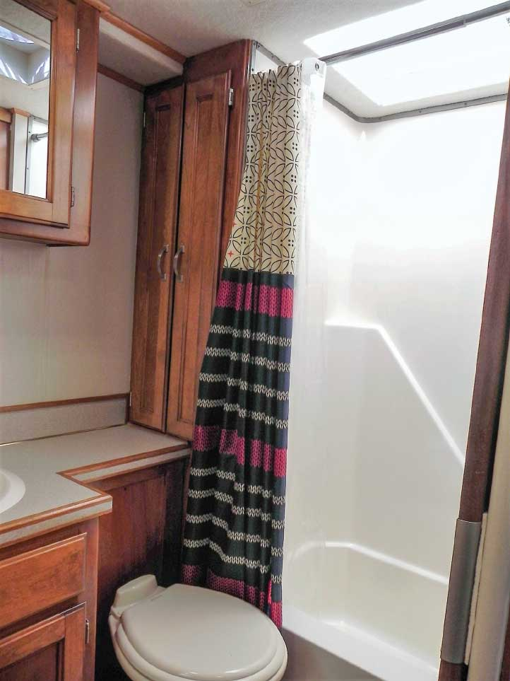 The rear bath has a new skylight and toilet, along with a refinished shower and sink.