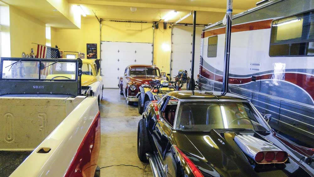 The Lees built a custom 2,800-square-foot basement garage to house their Winnebago. The extra space fueled Tom's passion for collecting vintage cars.