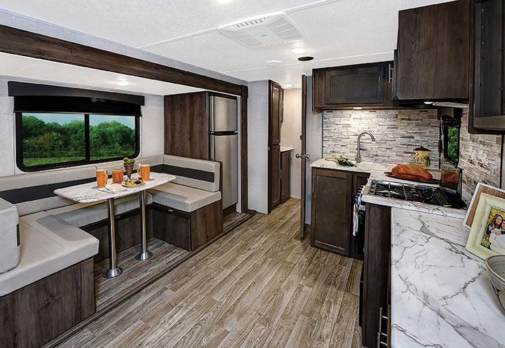 U-shaped dinette and kitchen in Coachmen Clipper Ultra-Lite 262BHS