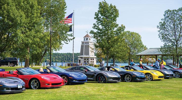 Corvettes parked on shoreline of Leech Lake in Walker, Minnesota