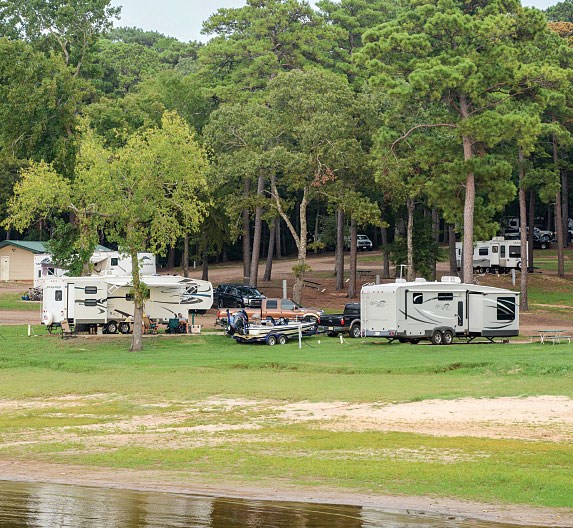 CRVs and trees at Cypres Bend RV Park in Many, Louisiana