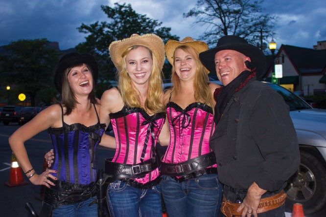 Dance-hall girls and the sheriff pose for photos after the Old West show at the Diamond Belle Saloon in the Strater Hotel.