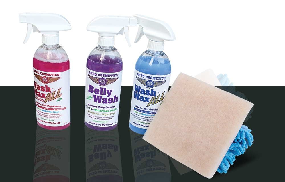 The Wash Wax All products we used include the red Wash Wax All Degreaser (left), the purple Belly Wash (center left), the blue Wash Wax All Cleaner, an Aero Scrubber Pad and a Waterless Mop Head (right).
