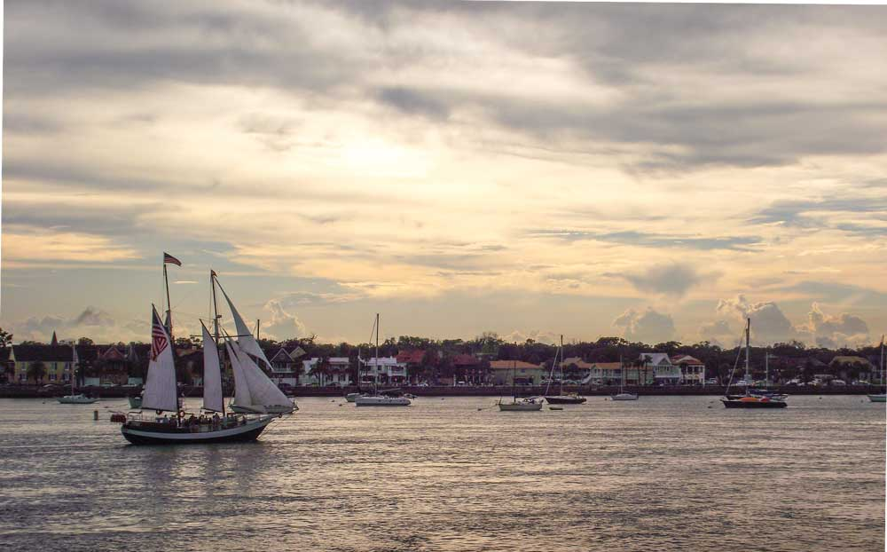 Anastasia Island offers picturesque sunset views of the Old City and sailing ships on Matanzas Bay.