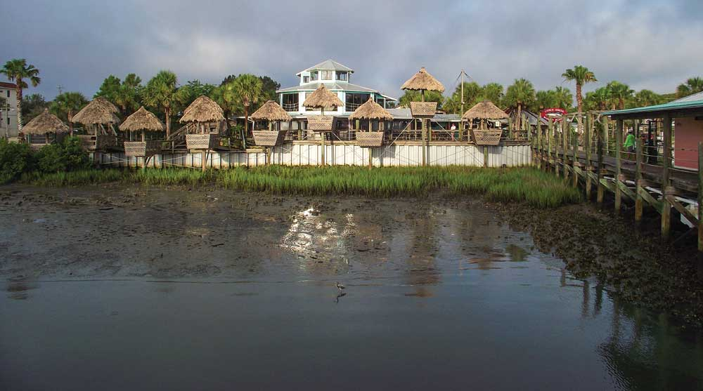 Enjoy an island-inspired lunch and drinks in a private Tiki hut at the famous Conch House Marina Resort