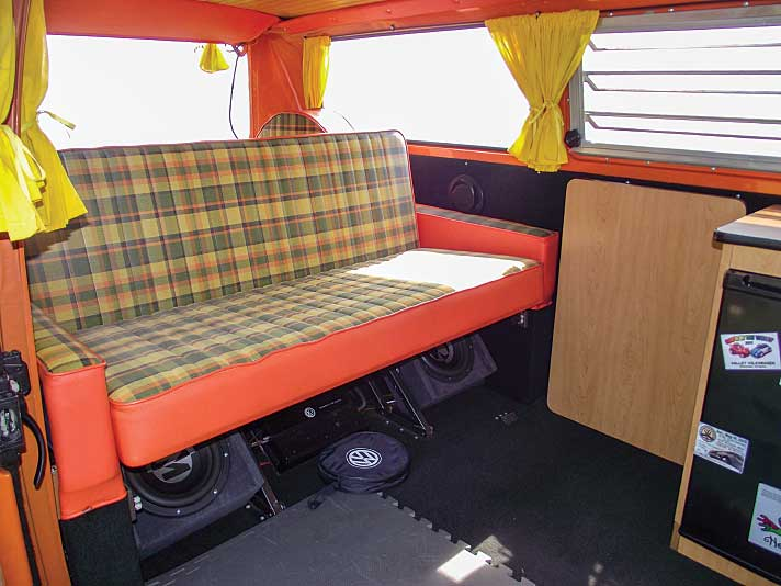 Interior of vintage 1973 VW Riviera Camper Van showing convertible couch