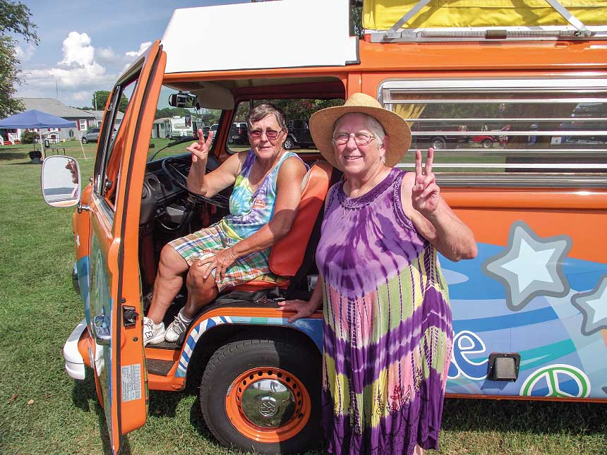 Owners D.K. Wills and Brenda Early, pose with their Peace Bus