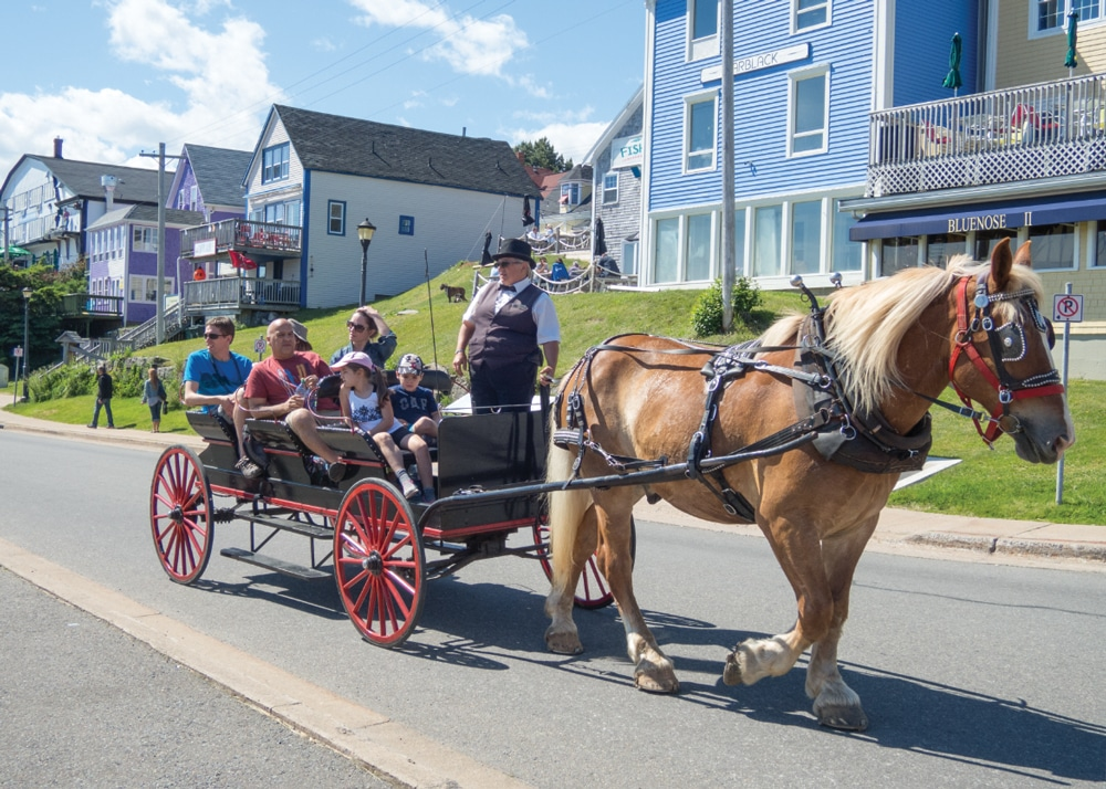 In Lunenburg, tourists see the sights in a horse-drawn wagon.