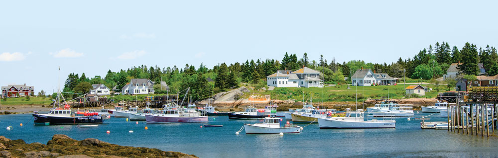 he Schoodic National Scenic Byway passes several iconic Maine harbors filled with lobster boats.