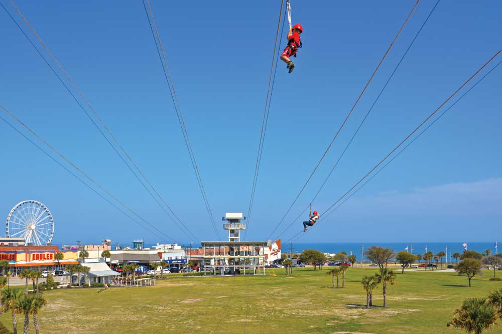 Visitors can choose their own adventures in Myrtle Beach. Thrill-seekers can whiz down ziplines with a view of the Atlantic.