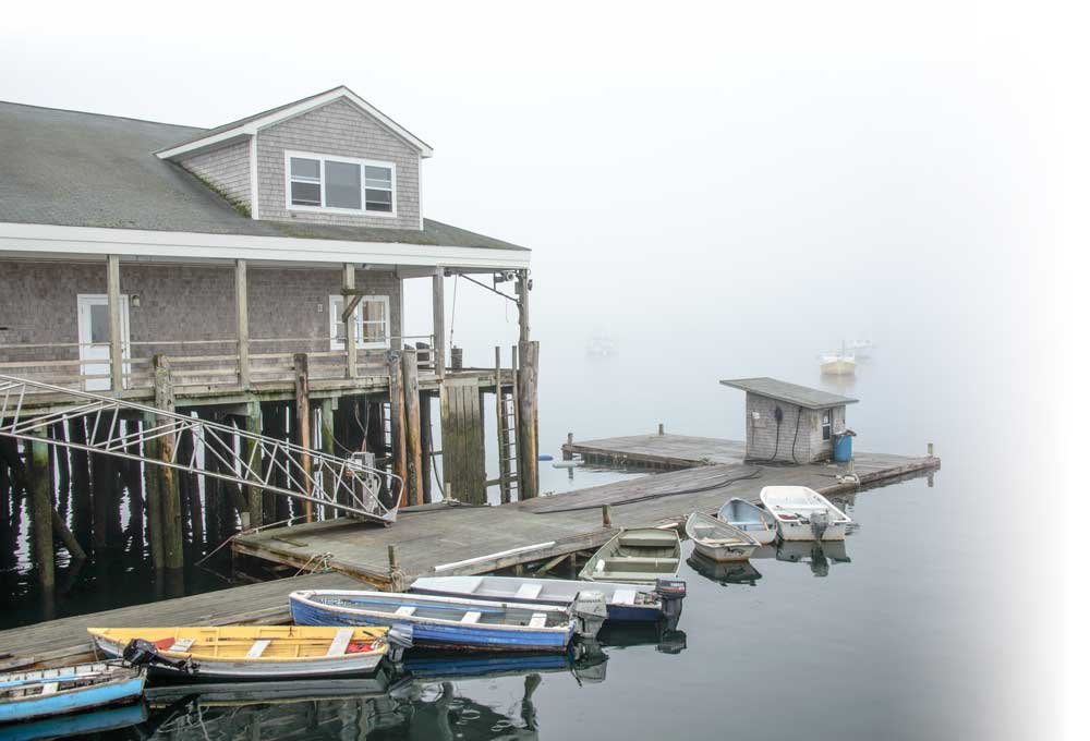 Mist and fog shroud the dinghy dock at Bass Harbor, a quaint fishing village on Mount Desert Island.