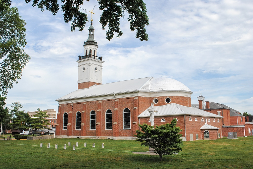 The elegant Basilica of St. Francis Xavier, also known as the Old Cathedral, was built in 1826 and is the fourth church on the site. It is located opposite George Rogers Clark National Historical Park.