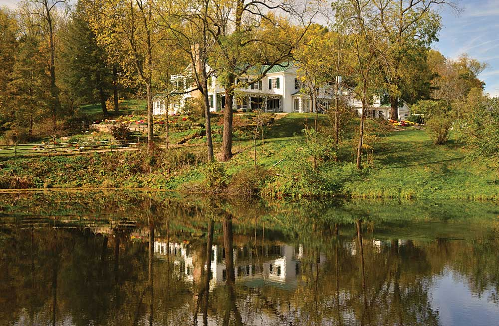 Pulitzer Prize- winning author Louis Bromfield's Big House at Malabar Farm is shown with fall colors in the surrounding trees.