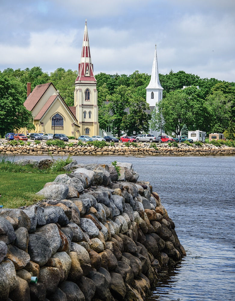 Completed in 1887, the elegant St. James church makes a striking image on the shores of Mahone Bay in the harbor town named for the waterway.
