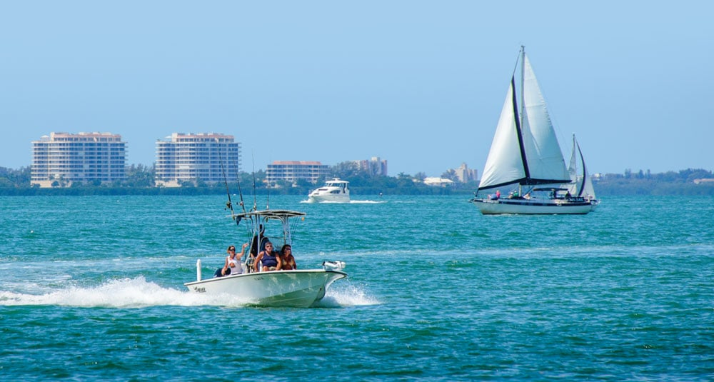 Sailboats and powerboats ply the turquoise bay waters off Centennial Park in the heart of Sarasota.