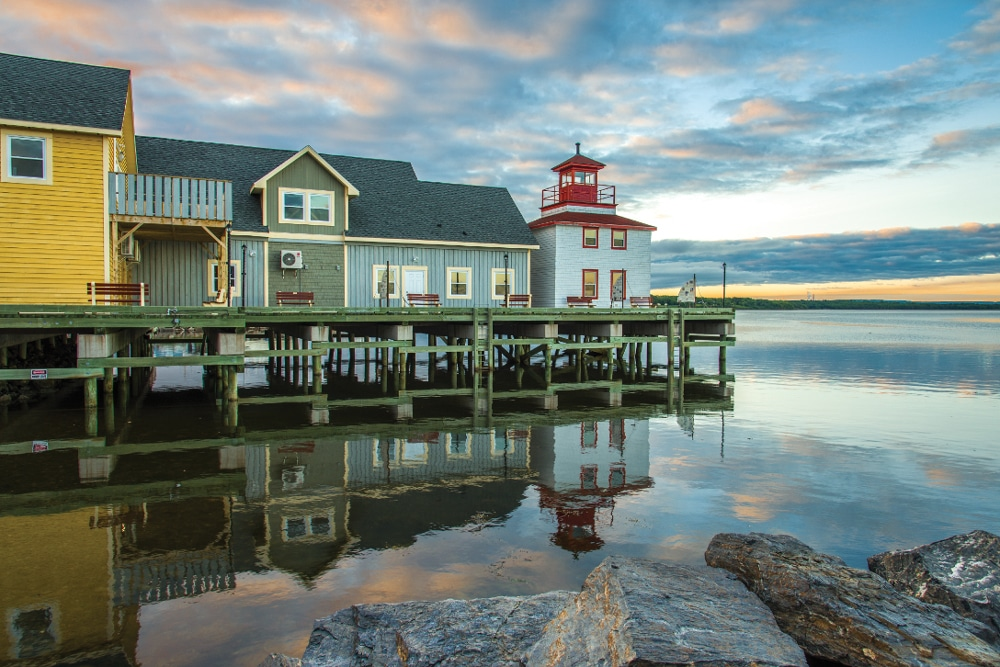 Classic waterfront buildings reflect the peace and tranquility of Pictou Harbor.
