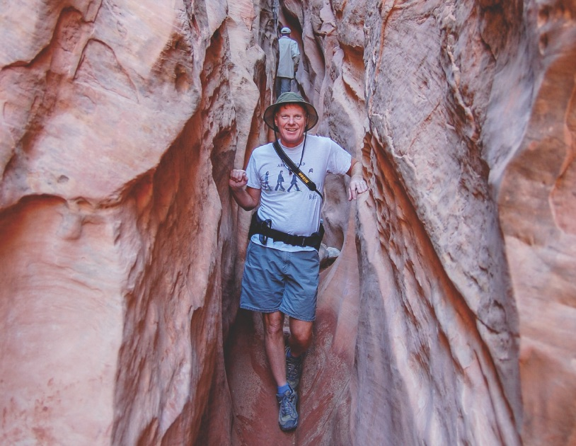 A hiker in a tight canyon