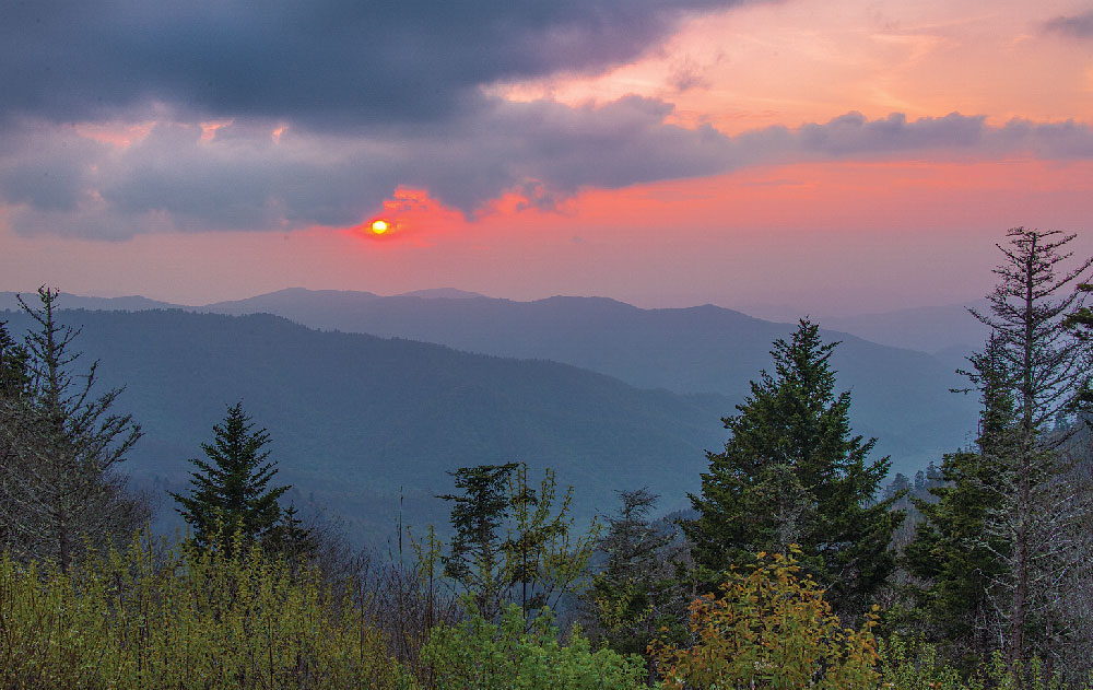 A classic Smokies sunset lights up the sky on the descent from Clingmans Dome, the highest point in Great Smoky Mountains National Park.
