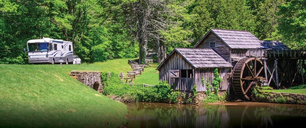 A motorhome drives past Mabry Mill at milepost 176.