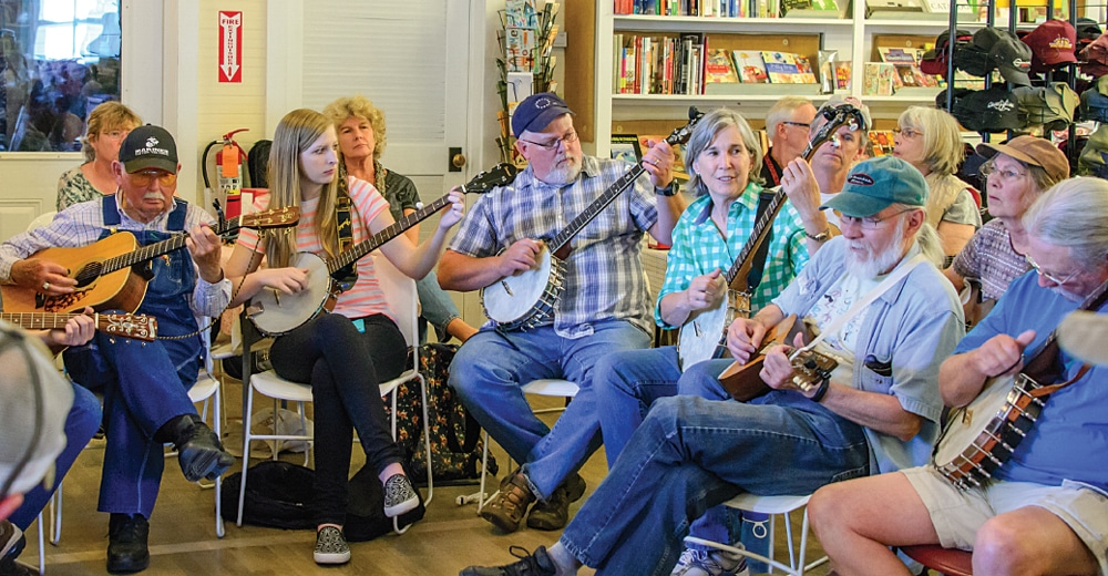 """Free bluegrass jam sessions delight at Floyd Country Store, where a sign declares """"Loitering allowed."""""""