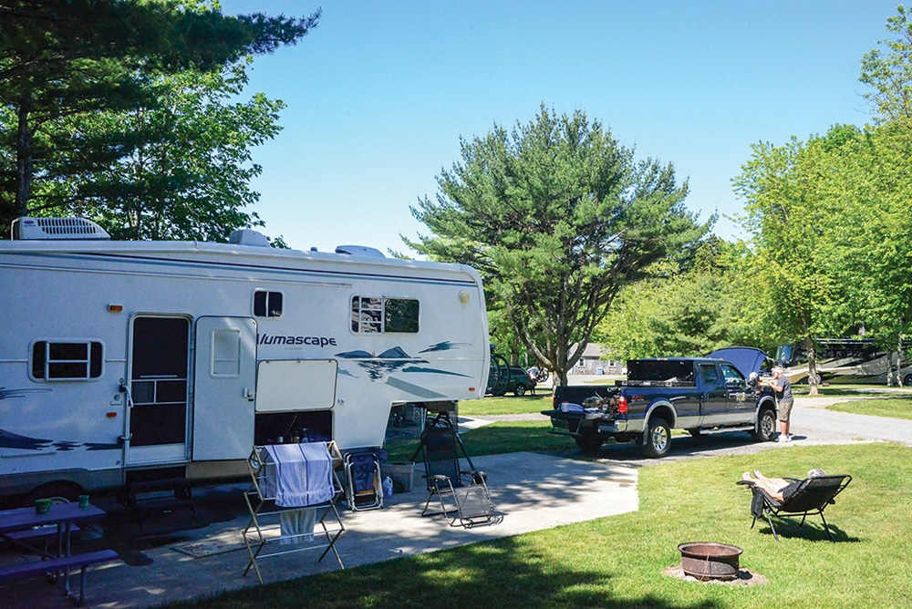 RVers relax and do a minor fix on their truck at Smuggler's Den Campground, with 47 full-hookup sites, just outside the town of Southwest Harbor.