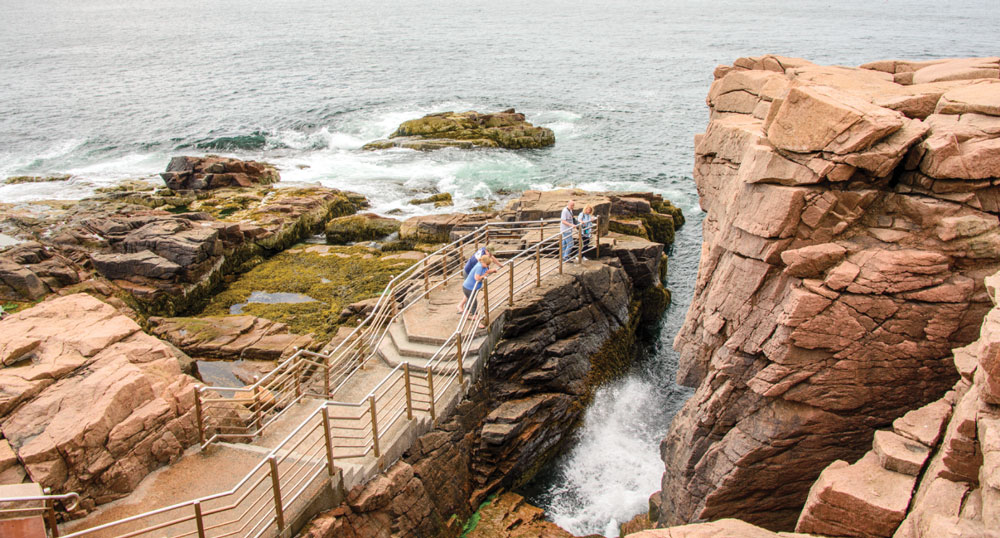 """Thunder Hole, on Park Loop Road, is a fun """"blow hole"""" where waves make booming sounds as they crash into a large cave hidden below the granite boulders on the shore."""
