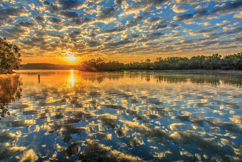Sunrise reflected in lake surface