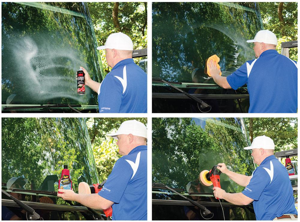 Man cleaning motorhome windshield