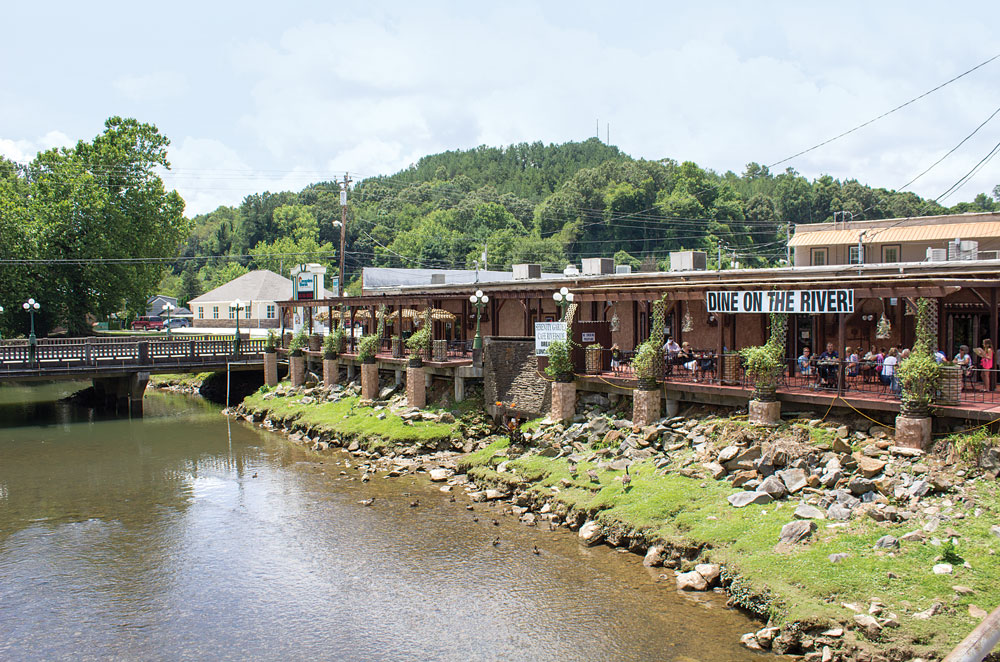 In the old mining town of McCaysville, riverside cafés are a relaxing place to dine and enjoy a view of the Toccoa River. The Georgia-Tennessee border runs through the center of town.