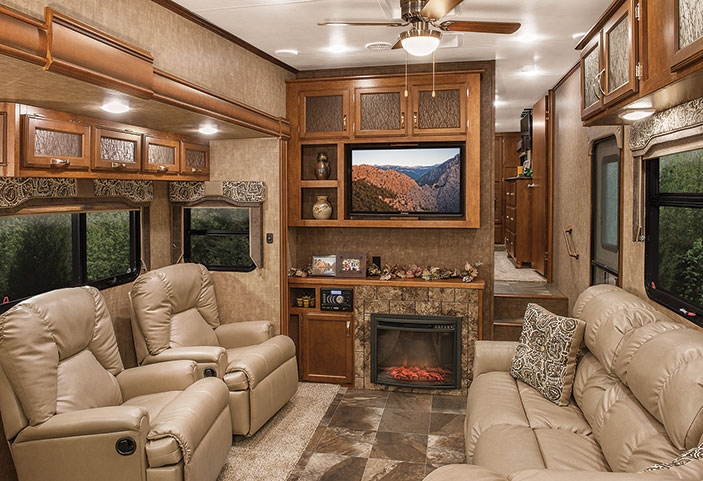 Two recliners and an opposing couch provide plenty of seating to enjoy the fireplace and entertainment center.