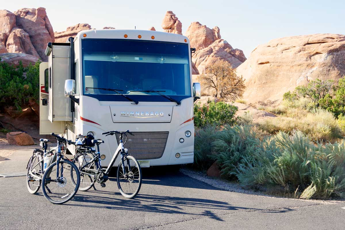 The authors' e-bikes in front of their Winnebago motorhome.