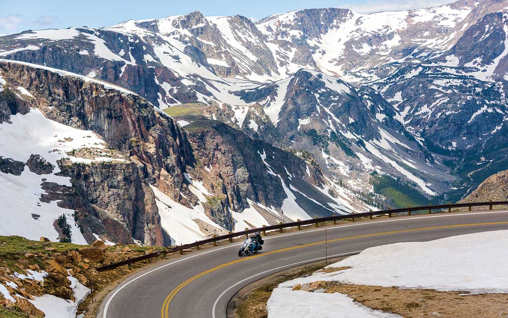 A motorcyclist cruises the Beartooth Highway