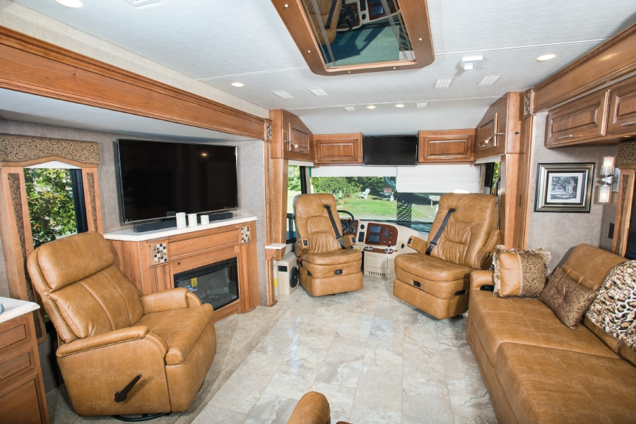 The comfy Ultraleather pilot and co-pilot seats, in addition to the living-area furniture, are by Villa. The freestanding recliner can be moved as necessary.