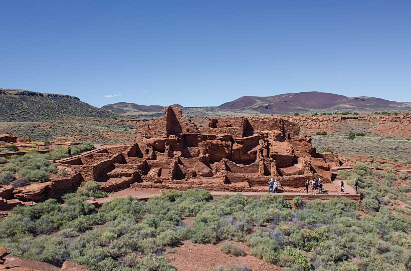 The Wupatki Ruins Complex at Wupatki National Monument includes a dwelling with more than 100 rooms, a community room, a ball court and two kivalike structures.