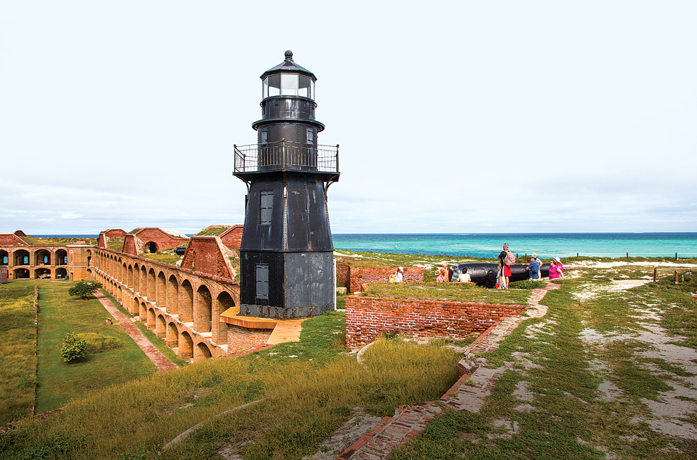 A harbor light towers above Fort Jefferson, a Civil War fortress preserved within the bounds of Dry Tortugas National Park.