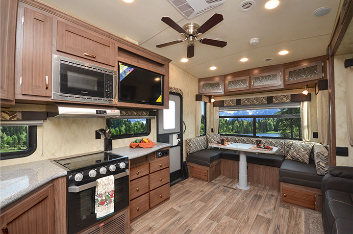 Interior showing kitchen and dinette of Northwood Fox Mountain 265RDS