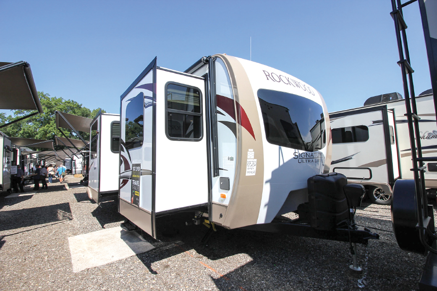 Rockwood travel trailer with two slide outs parked