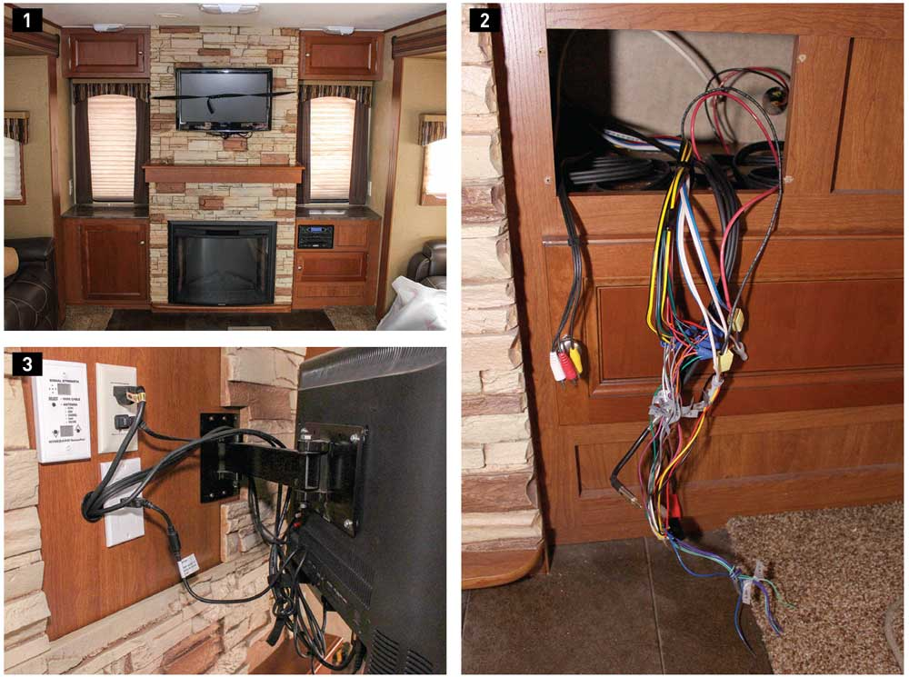 1) The original entertainment system, which consisted of a basic DVD stereo and a TV held to the wall with a vinyl strap for transit, was adequate but needed to be updated. 2) Removing the stereo revealed the wiring harness and RCA connections to the factory-installed TV. These had to be changed to a new harness, and an HDMI cable was added for the HDMI-ARC feature. 3) The original TV has a basic nonlocking articulating mount that didn't reach out far enough for good viewing from the couch or the theater seating. Also, there wasn't enough wiring for the entertainment system to connect to the TV.