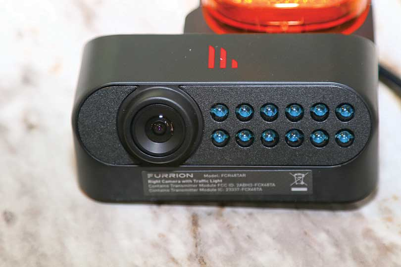 a close-up of the right marker-light camera lens and infrared LED array for night vision.